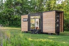 A lot of tiny houses look a bit like little dollhouses on wheels—peaked roof, petite double-hung windows, a tiny, almost vestigial porch