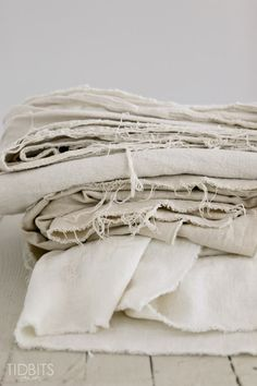 Fill top load washer with water - add 8 cups of bleach - submerge drop cloth in bleach water  - soak for 3 hours - spin and drain the water - run  through 2  complete cycles of washing with  regular detergent  - DMW