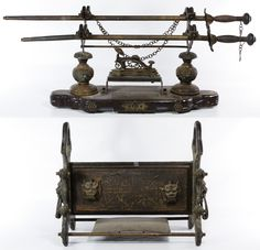 Lot 375: Asian Decorative Metal Sword Stands; Including two 20th century holders made of cast metal and wood; together with two rapier style swords