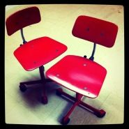 Vintage red rolling chairs unearthed