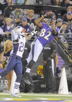Torrey Smith catches a touchdown pass over New England's Kyle Arrington. Game 3 vs Pat's 9/23