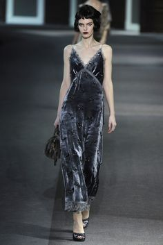 Louis Vuitton's 2013 RTW collection featured evening gowns with bias cuts. This method is still widely used in modern eveningwear as it was back in the 1920's. Unlike the past where it seemed to be only used on satin, the bias cut is now used on a variety of fabrics such as velvet as pictured above. The styling above suggests a reference to the years in which the bias cut originated through the bobbed hair and red lips.