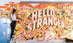 Wide shot of my Hello Stranger mural installation for @72andsunny_  taken by @maddy_ritchie ☀️. Hidden in the artwork are some references to the cities of the 72&Sunny offices: the Brooklyn bridge, hotdog flowers for NYC and taco plants for LA, plus the Art and Science Museum in Singapore and a bicycle + cheeky plant for Amsterdam!