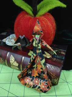 Needle felted apple with origami witch and her bat familiar (by Kathleen Dodge-DeHaven)