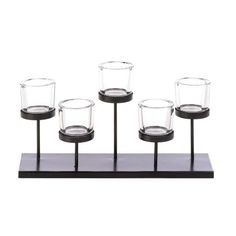 Five candles, five platforms, five cups all add up to a dazzling display of style. This metal candle holder features a staggered design that will capture your i