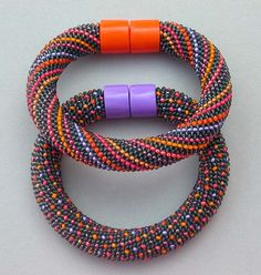 .Hildegund llkerl - Variations, Orange & Lilac, 2009.Bracelets. Medium Czech glass seed beads (bead crochet), hand forged metal/polymer clay magnetic clasp.