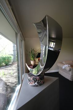 Take a look at what Ryan T. Schmidt of the Schmidt Gallery has to display.  His captivating stainless steel sculptures are here, Little Rock, and worldwide.