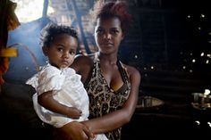 Viviame Razafandrasoa, who gave birth a year ago and already has seven other children, arrives at a health centre for treatment after miscarrying a baby at two months in the village of Manatsatiana,near  Fenerive Est, Madagascar Wednesday, Sept. 17, 2014. Viviame says that she wasn't using family planning because her husband didn't approve which is why she got pregnant so quickly after her last child.  (Kate Holt/MCSP)