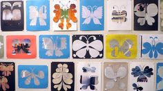 Hand-cut butterflies by Lucia Eames made of recycled paper.