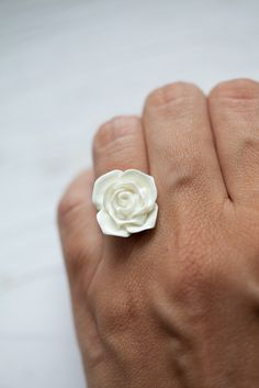 White glossy flower ring