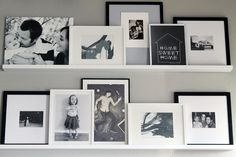 photo ledges using RIBBA picture ledges from IKEA. Just went to ikea and bought the stuff to do this