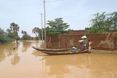 A family uses a boat to get around due to flooding in Niamey, Niger, August 2012. A ShelterBox Response Team is on the ground working with the IOM
