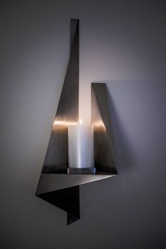 Large Candle Wall Sconce, Custom Stainless steel, USA 1970s | From a unique collection of antique and modern candle holders at https://www.1stdibs.com/furniture/decorative-objects/candle-holders/