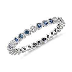 Simply indulgent, this eternity ring features blue sapphire and round brilliant diamonds crafted in a petite design of 14k white gold. Wear alone or stacked with other gemstone rings.