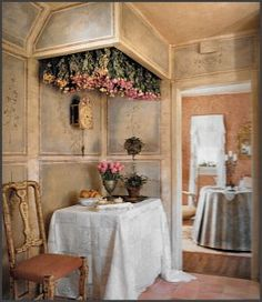 From one of my favorite design books, dried roses in a cove hanging from the ceiling.