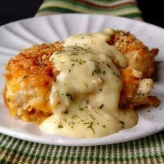 Crispy Cheddar Chicken Recipe  2lbs chicken tenders or 4 large chicken breasts  ;   2 sleeves Ritz crackers ¼teaspoons salt ⅛teaspoon pepper  ;    ½cup whole milk  ;    3cups cheddar cheese, grated   ; 1teaspoon dried parsley   ;     Sauce:     110 ounce can cream of chicken soup  ;   2tablespoon sour cream  ;    2tablespoon butter   ;
