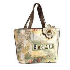 """Demdaco Kelly Rae Roberts Fashion Create Tote - Create. 21"""" drop strap. Includes two pockets and one zipper pocket inside."""