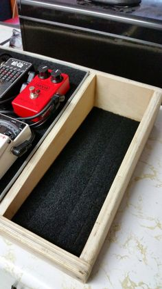 DIY guitar pedalboard work in progress. Velcro matting in volume / wah pedal bay.