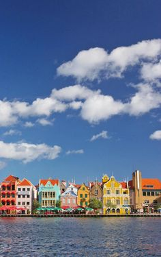 Colors line the water in Willemstad, Curaçao. #caribbean