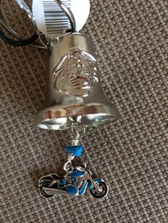 Unique and different motorcycle bell with American flag and blue motorcycle charm. by RealBeadDesigns on Etsy