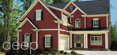 Don't know if I could dare to go with Farmall Red with black shutters but this an example of stunning colors for this home