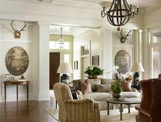Melanie Davis {Davis Designs, Atlanta}  look at matching consoles for LR   Striped chair in den...