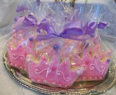 "4.5""- Princess Crown sugar cookies with edible glitter and pearls.  $3.00 each/ $36.00 a dozen  *all cookies come individually wrapped with a satin ribbon"