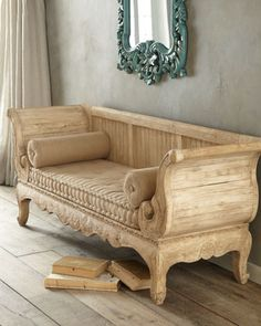 """""""Berkshire"""" Sofa at Horchow. This sofa is a replica of an antique wooden bench discovered in a barn in Lookeren, Belgium. The original is believed to have been an early 19th-century work from Sweden, and its unique weather-beaten finish provided quite a challenge for our antiques restorers to recreate."""
