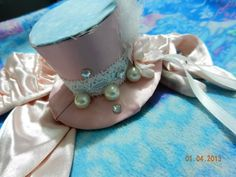 Pink and blue pearl and rhinestone lace feather mini top hat. Available for sale!