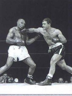 Rocky Marciano, 29, slugs the World Heavyweight Champion, 38-year-old Jersey Joe Walcott, in Philadelphia, 1952