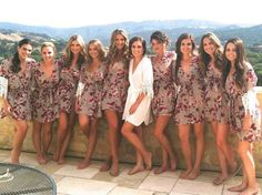 bride in white robe and bridesmaids in floral robes