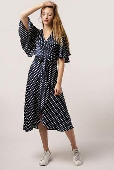 Our Polka Dot Wrap Dress welcomes warm weather with fluttery cape sleeves, v-neck wrap front with tie at waist, and maxi length. - Polyester - Dry clean only - Imported Sari Dress, Maxi Wrap Dress, Maxi Dress With Sleeves, Dress Skirt, Dresses Dresses, Mid Length Dresses, Spring Dresses, Pretty Dresses, Fashion Looks
