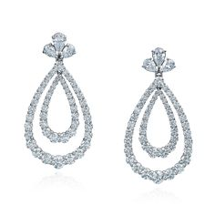 Round and pear shape diamond earrings