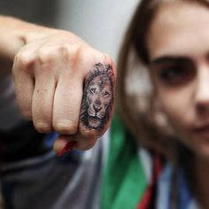 Cara Delevingne | Cara Delevigne's lion tattoo on the finger, by Bang Bang. Tattoo artist: Bang Bang · Keith McCurdy
