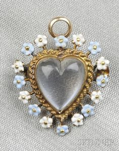 IMAGE: Art Nouveau gold, moonstone, and enamel heart pendant/brooch, the cabochon moonstone heart surrounded by enamel forget-me-nots Heart Locket Necklace, Heart Jewelry, Heart Necklaces, Wire Jewelry, Jewellery, Antique Jewelry, Vintage Jewelry, Antique Art, Handmade Jewelry