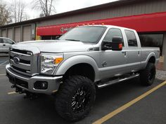 Zone Lift Kit with American Eagle Hard Rock Series Wheels and Nitto Mud Grappler Tires. Custom Wheels And Tires, Lift Kits, Hard Rock, Mud, Truck, Eagle, American, Trucks, Hard Rock Music
