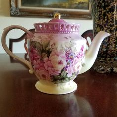 Beautiful hand painted Tea Pot with Floral Bouquet of pink roses with yellow bowls that blossom out to produce pink petals , surrounding the roses are blue daisies, and Lilac . The tea pot has a beautiful Cut crown around the lid. Vintage Dishes, Vintage Tea, Yellow Bowls, Cuppa Tea, Tea Pot Set, Pink Petals, Teapots And Cups, Tea Service, My Cup Of Tea