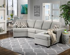 Comfort Centre. The Downtown sectional sofa draws family and friends to your living room with its style and comfort. With a stretch out-worthy chaise on one side and the curl up-friendly curved cushion on the other, this sectional sofa promises relaxation all around. Three multi-hued geometric toss pillows offer modern accents. Made in Canada.   Special order item. Please allow approximately 8-10 weeks for delivery.