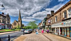 Ilkley, West Yorkshire. Lovely town. Beautiful part of England.There's a proper tea shop, great boutiques, and quaint pubs all around the town center. Take your camera.    Photo is a screen capture from Flickr.
