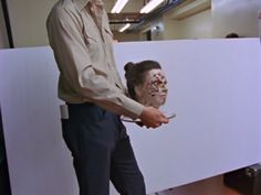 During a closing montage in Vivian Kubrick's documentary on the making of The Shining, Stanley Kubrick can be seen filming a test in the kitchen hallway, using a wound-ridden prosthetic head of a woman with her hair pulled back in a bun.  Gordon Stainforth, editor of Vivian Kubrick's documentary, confirmed that this was an early make-up test for the woman in Room 237, created by make-up artist Tom Smith. Kubrick filmed the test to see how the prosthetic would read on 35mm film…