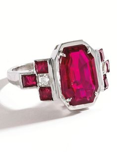 J.E. Caldwell - A Vintage Platinum, Ruby and Diamond Ring, Circa 1950. Centred by an octagonal-shaped ruby weighing 3.96 carats, flanked by six calibré-cut rubies weighing approximately .60 carat and two French-cut diamonds weighing approximately .40 carat, signed JEC & Co. #Caldwell #vintage