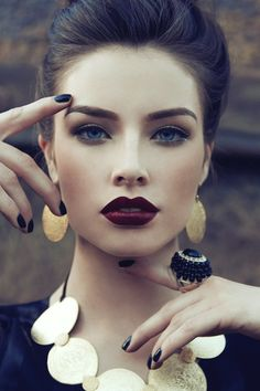 Bordeaux lipstick is perfect for fall. Wear with black mascara  and neutral shadow.
