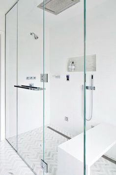 Clean Design Partners - Thassos & Carrara Bella marble chevron tile floor, seamless glass shower, sleek white vanity & counter ...