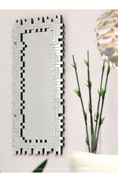 Shard Mirror - 850031Description :Made of oblongs in a stunning Jenga configuration, this mirror works in the hall by the door or hung sideways over the fireplace. Each mirror features brackets for hanging vertically or horizontally.Features :Color :ClearProduct Cover (Upholstery Material or Type of Metal) :MirrorProduct Finish (Structure Materiel or Type of Wood) :WoodDimensions :Mirror:47