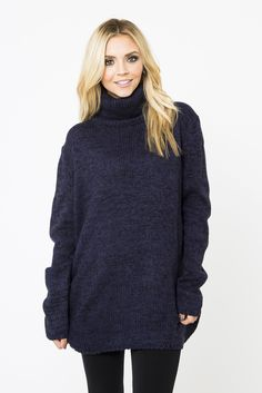 Think of the hues in gorgeous Baltic twilight and then think of this inspired, marled sweater. Purple, blue, and black acrylic yarns are woven together to make a sophisticated silhouette with a shaped hem and cozy turtleneck and will keep you warm all night long. Hand wash, dry flat.