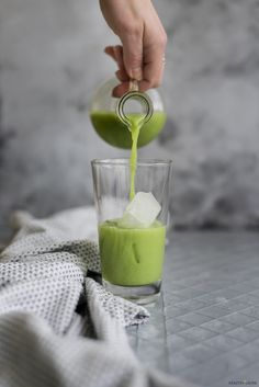 Iced Matcha Latte by HealthyLaura. Food Photography. Ice. Grey. Green. Bluish. Pour. Action. Contrast.