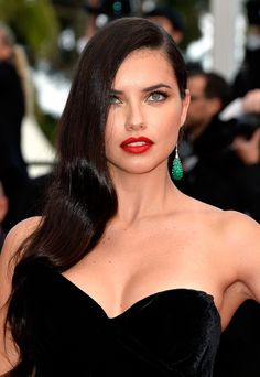 Adriana Lima brought her signature sex appeal to the Cannes Film Festival with glamorous and glossy waves, dewy skin and classic red lips.