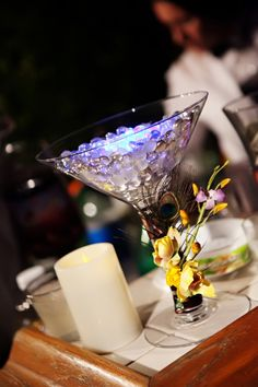 Large martini glass with led and glass beads, trimmed with an orchid stem. $20.00