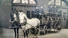 Erie Fire Department .  Turn of the century horse drawn rig sitting in front of Engine 9, once located at West 11th and Poplar Street.