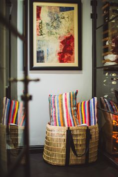 Colourful soft furnishings and woven basketry